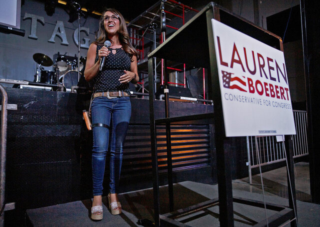 FILE - Businesswoman Lauren Boebert speaks during a watch party at Warehouse 25 Sixty Five in Grand Junction, Colo., after polls closed in Colorado's primary election on Tuesday, June 30, 2020. Boebert, a pistol-packing restaurant owner who has expressed support for a far-right conspiracy theory has upset five-term Colorado U.S. Rep. Scott Tipton. Lauren Boebert is an ardent defender of gun rights and border wall supporter. She will run in November's general election against Diane Mitsch Bush, who won the Democratic nomination on Tuesday.  (McKenzie Lange/Grand Junction Sentinel via AP, File)