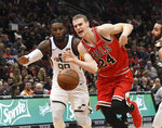 Chicago Bulls forward Lauri Markkanen (24) and Utah Jazz forward Jae Crowder (99) go for a loose ball during the first half of an NBA basketball game Saturday, March 23, 2019, in Chicago. (AP Photo/David Banks)
