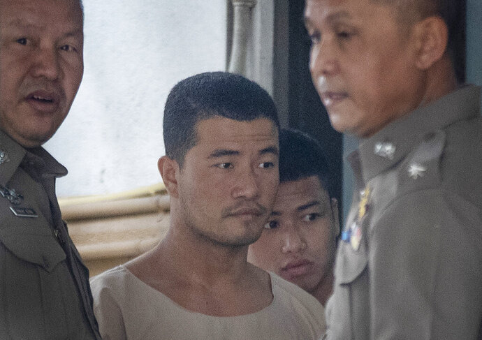 Myanmar nationals Wai Phyo, second left, and Zaw Lin, second right, are escorted by police officers at Supreme Court in Bangkok, Thailand, Thursday, Aug. 29, 2019. The court has upheld the 2015 conviction of the two Myanmar migrants sentenced to death for the murder of two British backpackers on a resort island in 2014. (AP Photo/Sakchai Lalit)