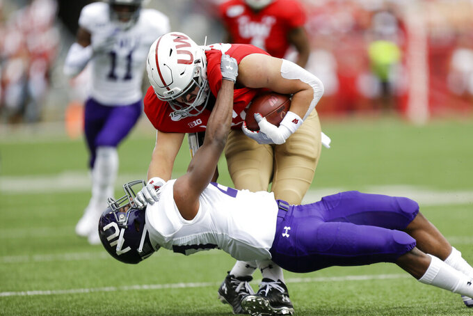 Taylor, defense lead No. 8 Badgers past Northwestern 24-15