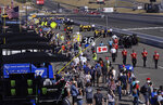 Cars are pushed into pit row in preparation for a NASCAR Sprint Cup Series auto race Sunday, June 23, 2019, in Sonoma, Calif. (AP Photo/Ben Margot)