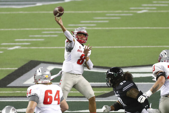 New Mexico quarterback Tevaka Tuioti throws a pass against Hawaii during the first quarter of an NCAA college football game Saturday, Nov. 7, 2020, in Honolulu. (AP Photo/Marco Garcia)
