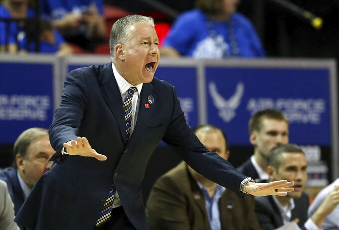 Air Force head coach Dave Pilipovich instructs his team during the first half of a Mountain West Conference tournament NCAA college basketball game against San Diego State, Thursday, March 5, 2020, in Las Vegas. (AP Photo/Isaac Brekken)