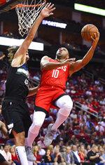 Houston Rockets guard Eric Gordon (10) shoots as Milwaukee Bucks center Robin Lopez defends during the first half of an NBA basketball game Thursday, Oct. 24, 2019, in Houston. (AP Photo/Eric Christian Smith)