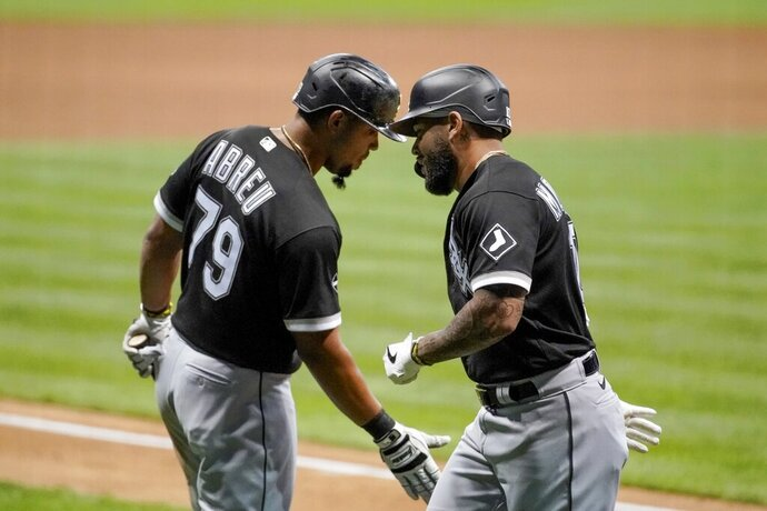 Chicago White Sox's Yoan Moncada is congratulated by Jose Abreu (79) after hitting a home run during the ninth inning of a baseball game against the Milwaukee Brewers Monday, Aug. 3, 2020, in Milwaukee. (AP Photo/Morry Gash)