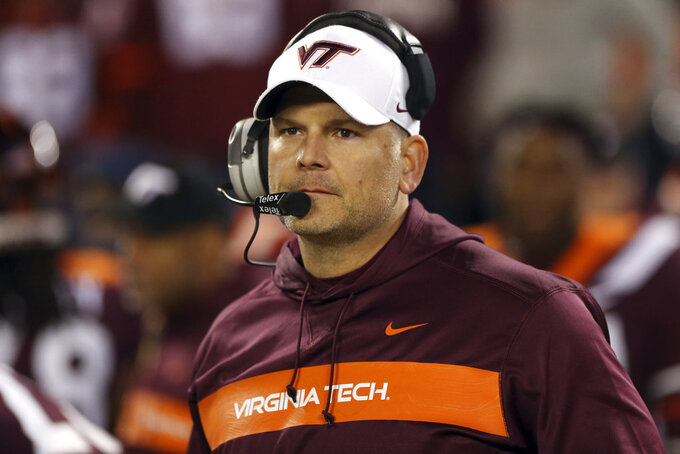 FILE - In this Oct. 25, 2018, file photo, Virginia Tech coach Justin Fuente awaits the start of the team's NCAA college football game against Georgia Tech in Blacksburg Va.  Now, Virginia Tech (6-6) must defeat Cincinnati on Monday, Dec. 31, to avoid its first losing season since 1992. (Matt Gentry/The Roanoke Times via AP, File)