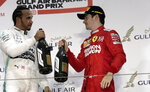 First place, Mercedes driver Lewis Hamilton of Britain, left, and third place, Ferrari driver Charles Leclerc of Monaco stand on the podium after the Bahrain Formula One Grand Prix at the Bahrain International Circuit in Sakhir, Bahrain, Sunday, March 31, 2019. (AP Photo/Hassan Ammar)