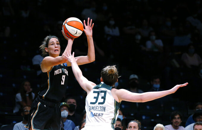 New York Liberty guard Rebecca Allen (9) shoots a 3-pointer over Seattle Storm forward Katie Lou Samuelson (33) during the second half of a WNBA basketball game Wednesday, Aug. 18, 2021, in New York. (AP Photo/Noah K. Murray)
