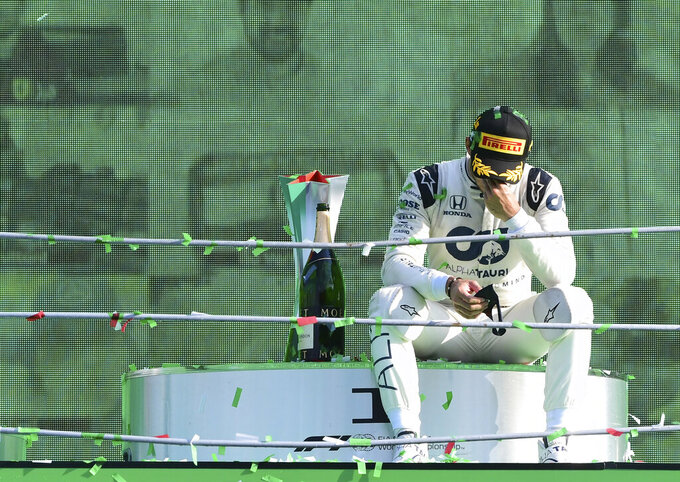 AlfaTauri driver Pierre Gasly of France reacts on the podium after winning the Formula One Grand Prix at the Monza racetrack in Monza, Italy, Sunday, Sept.6 , 2020. (Jennifer Lorenzini, Pool via AP)