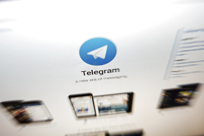 FILE - In this Thursday, June 13, 2019, file photo, the website of the Telegram messaging app is seen on a computer's screen in Beijing. German authorities have launched proceedings against Telegram that could see the messenger app's operators fined for failing to abide by laws requiring social media sites to police their users' actions. (AP Photo/Andy Wong, file)