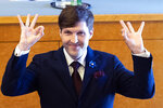 In this photo taken on Monday, April 29, 2019, Estonian Finance Minister Martin Helme, son of Mart Helme, head of the Estonian Conservative People's Party, or EKRE, gestures while speaking during the presentation of the new government in Tallinn, Estonia. Mart Helme and his son, Finance Minister Martin Helme, were caught Monday by photographers at the ceremony making fingers gestures with their thumb and index finger to resemble a white supremacy sign. Mart Helme hasn't commented the gestures(Liis Treimann, Aripaev via AP)