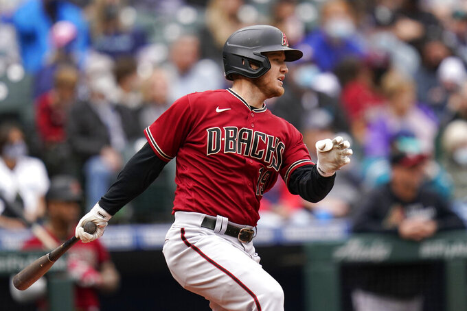 Arizona Diamondbacks' Josh VanMeter singles to drive in a run against the Seattle Mariners in the third inning of a baseball game Sunday, Sept. 12, 2021, in Seattle. (AP Photo/Elaine Thompson)