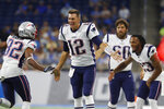 New England Patriots quarterback Tom Brady (12) and teammates congratulate wide receiver Maurice Harris (82) after his touchdown during the first half of a preseason NFL football game against the Detroit Lions, Thursday, Aug. 8, 2019, in Detroit. (AP Photo/Paul Sancya)