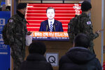 South Korean army soldiers pass by a TV screen showing the live broadcast of South Korean President Moon Jae-in's New Year's speech at the Seoul Railway Station in Seoul, South Korea, Tuesday, Jan. 7, 2020. Moon said he hopes to see North Korean leader Kim Jong Un fulfill a promise to visit the South this year as he called for the rival Koreas to end a prolonged freeze in bilateral relations. (AP Photo/Ahn Young-joon)