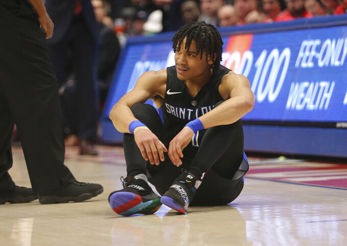 St. Louis guard Yuri Collins (1) reacts after a referee's call during the first half of an NCAA college basketball game against Dayton , Saturday, Feb. 8, 2020, in Dayton, Ohio. (AP Photo/Tony Tribble)