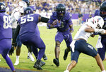 TCU running back Zach Evans (6) runs the ball in for a touchdown behind the block of offensive tackle Obinna Eze (55) against Duquesne during the first half of an NCAA college football game Saturday, Sept. 4, 2021, in Fort Worth, Texas. (AP Photo/Ron Jenkins)