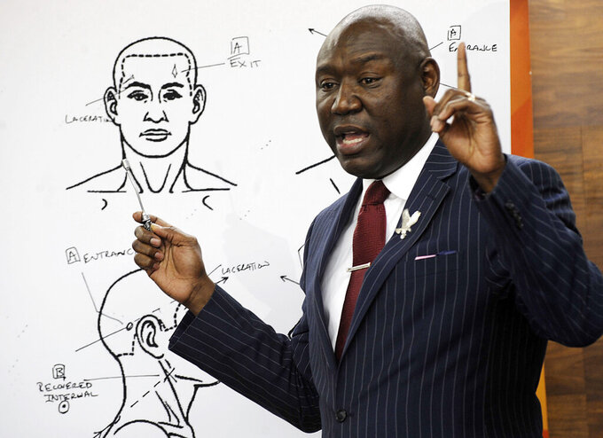 """FILE - In this Monday, Dec. 3, 2018 file photo, attorney Ben Crump holds a news conference in Birmingham, Ala., to discuss the results of a forensic examination on Emantic """"EJ"""" Bradford Jr., who was fatally shot by police in a shopping mall on Thanksgiving day. Crump, who represents Bradford's family, says a report shows the 21-year-old black man suffered three gunshot wounds to the back side of his body. (AP Photo/Jay Reeves)"""