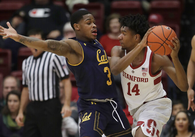 Stanford guard Marcus Sheffield (14) is defended by California guard Paris Austin (3) during the first half of an NCAA college basketball game in Stanford, Calif., Thursday, March 7, 2019. (AP Photo/Jeff Chiu)