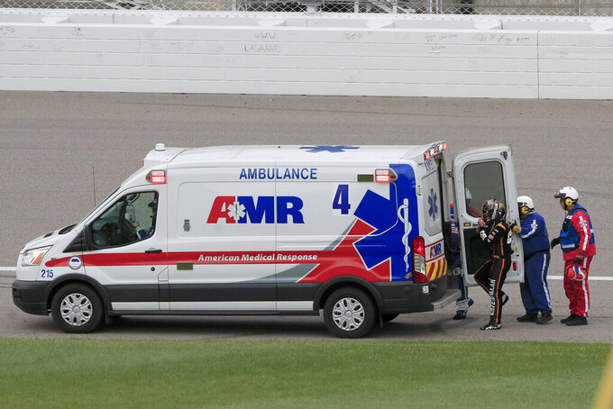 Daniel Hemric (8) steps into an ambulance after wrecking during a NASCAR Cup Series auto race at Kansas Speedway in Kansas City, Kan., Sunday, Oct. 20, 2019. (AP Photo/Orlin Wagner)