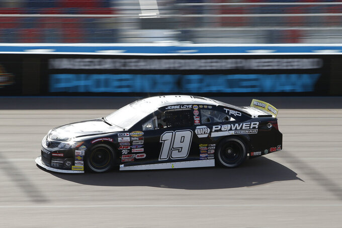 Jesse Love drives through Turn 4 during an ARCA Series auto race at Phoenix Raceway, Saturday, Nov. 7, 2020, in Avondale, Ariz. (AP Photo/Ralph Freso)