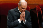 FILE - In this Oct. 6, 2018, file photo, The Church of Jesus Christ of Latter-day Saints President Russell M. Nelson prays during the church's twice-annual, in Salt Lake City. The Church of Jesus Christ of Latter-day Saints will celebrate president Nelson's 95th birthday with a gala in Salt Lake City. A church news release says the event will focus on Nelson's lifelong service to the Utah-based faith. (AP Photo/Rick Bowmer, File)