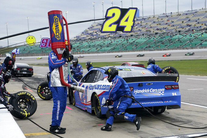 William Byron (24) pits during a NASCAR Cup Series auto race at Kansas Speedway in Kansas City, Kan., Sunday, Oct. 18, 2020. (AP Photo/Orlin Wagner)