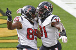 Houston Texans running back David Johnson (31) celebrates with Pharaoh Brown (85) after scoring a touchdown against the Pittsburgh Steelers during the first half of an NFL football game, Sunday, Sept. 27, 2020, in Pittsburgh. (AP Photo/Don Wright)