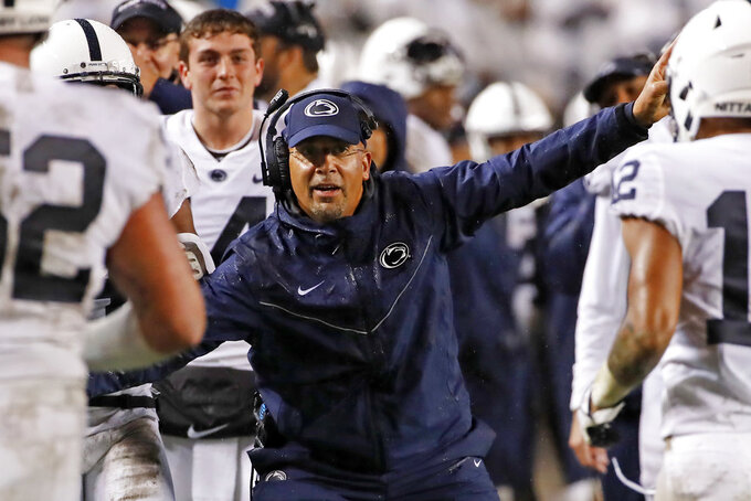 FILE - In this Sept. 8, 2018 file photo Penn State coach James Franklin, center, celebrates as players return to the sidelines after a touchdown during the second half of an NCAA college football game against Pittsburgh in Pittsburgh. Franklin is all too familiar with the scenario he faces. He watched the Nittany Lions' conference title hopes and playoff possibilities slip away with back-to-back road losses last October. Two early losses during a three-week stretch in 2016 kept the eventual Big Ten champs out of the playoffs. And now No. 18 Penn State needs to turn things around at Indiana after losing two straight home games. (AP Photo/Gene J. Puskar, file)