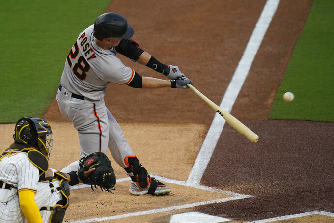 San Francisco Giants' Buster Posey hits a home run during the first inning of a baseball game against the San Diego Padres, Friday, April 30, 2021, in San Diego. (AP Photo/Gregory Bull)