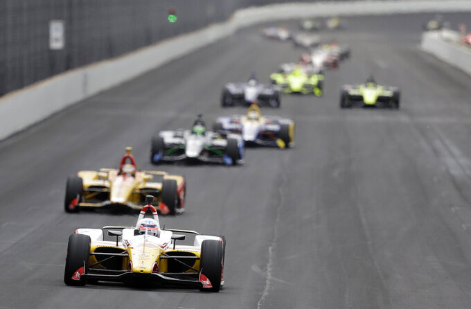 Takuma Sato, of Japan, leads a group of cars into turn one during practice for the Indianapolis 500 IndyCar auto race at Indianapolis Motor Speedway, Monday, May 20, 2019, in Indianapolis. (AP Photo/Darron Cummings)