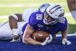 James Madison wide receiver Riley Stapleton (10) looks up after being tackled across the goal line by Monmouth linebacker DeJaun Cooper (8) during the first half of a second-round game in the NCAA Football Championship Subdivision playoffs Saturday, Dec. 7, 2019, in Harrisonburg, Va. (Daniel Lin/Daily News-Record via AP)