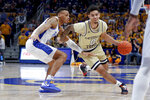 Georgia Tech's Michael Devoe (0) drives around Pittsburgh's Trey McGowens, left, during the first half of an NCAA college basketball game, Saturday, Feb. 8, 2020, in Pittsburgh. Much of Georgia Tech's optimism centers on the backcourt duo of Jose Alvarado and Michael Devoe. (AP Photo/Keith Srakocic, File)