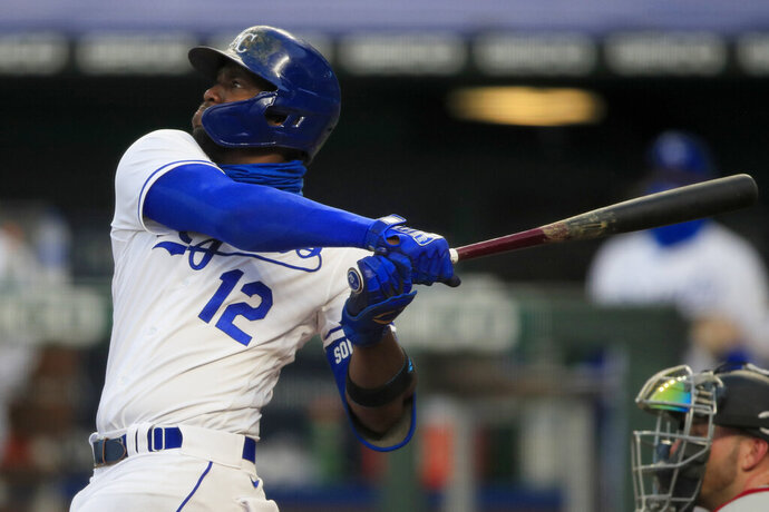 Kansas City Royals' Jorge Soler hits a three-run home run during the fourth inning of a baseball game against the Minnesota Twins at Kauffman Stadium in Kansas City, Mo., Saturday, Aug. 8, 2020. (AP Photo/Orlin Wagner)