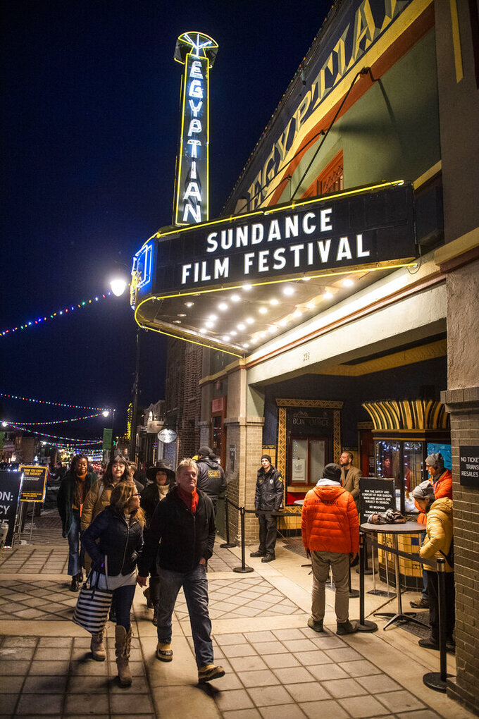 FILE - The marquee of the Egyptian Theatre promotes the 2020 Sundance Film Festival in Park City, Utah on Jan. 28, 2020. Organizers on Wednesday said that this year they will premiere over 70 films on a custom online platform during the seven day event. There will also be some socially distanced screening opportunities around the country. (Photo by Arthur Mola/Invision/AP, File)
