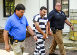 Oxford Police Officer Matthew Kinne, center, escorted by Lafayette County Sheriff deputies Jarrett Bundren, left, and Maj. Alan Wilburn, after hearing at the Lafayette County Courthouse, Wednesday, May 22, 2019, in Oxford, Miss. Kinne is charged in the death of 32-year-old Dominique Clayton, who was found dead Sunday. (Bruce Newman/The Oxford Eagle via AP)