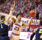 Indiana forward Trayce Jackson-Davis (23) drives to the basket during the second half of an NCAA college basketball game against Michigan, Saturday, Feb. 27, 2021, in Bloomington, Ind.  (AP Photo/Doug McSchooler)