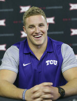 FILE - In this July 17, 2017, file photo, TCU linebacker Ty Summers laughs while speaking with reporters during the Big 12 NCAA college football media day in Frisco, Texas. Summers was an all-district dual-threat quarterback in high school. Since he started playing for No. 15 TCU, Summers has been on the other side chasing quarterbacks and making tackles all over the field. (AP Photo/LM Otero)