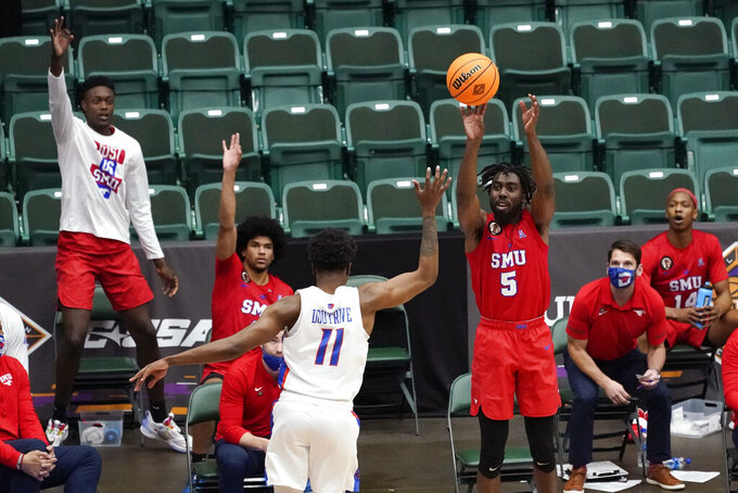 SMU guard Emmanuel Bandoumel (5) shoots a 3-point basket over Boise State guard Devonaire Doutrive (11) during the second half of an NCAA college basketball game in the first round of the NIT, Thursday, March 18, 2021, in Frisco, Texas. (AP Photo/Tony Gutierrez)