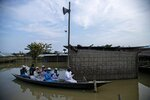 Flood affected Muslims offer Eid al-Adha prayers on a boat near a submerged mosque in Morigaon district of Assam, India, Saturday, Aug. 1, 2020. Muslims worldwide marked the the Eid al-Adha holiday over the past days amid a global pandemic that has impacted nearly every aspect of this year's celebrations. (AP Photo/Anupam Nath)