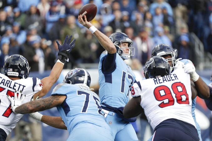 Tennessee Titans quarterback Ryan Tannehill (17) passes against the Houston Texans in the first half of an NFL football game Sunday, Dec. 15, 2019, in Nashville, Tenn. (AP Photo/James Kenney)