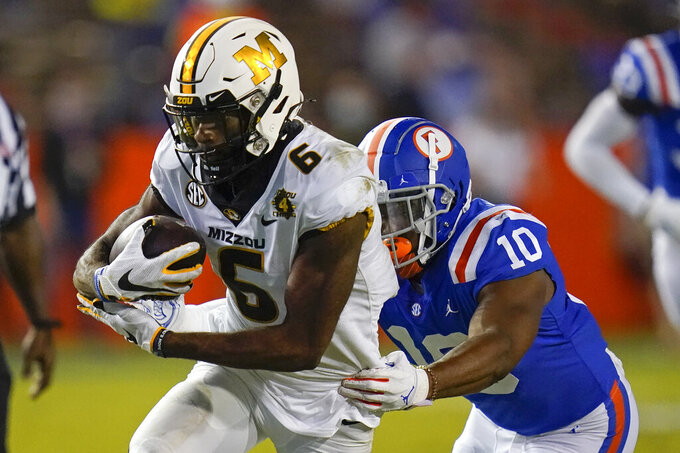 Missouri wide receiver Keke Chism (6) makes a reception in front of Florida linebacker Andrew Chatfield Jr. (10) during the second half of an NCAA college football game Saturday, Oct. 31, 2020, in Gainesville, Fla. (AP Photo/John Raoux)