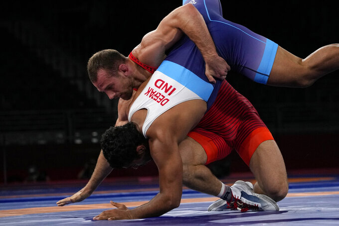 United States' David Morris Taylor III, background, and India's Deepak Punia compete in the men's 86kg Freestyle semifinal wrestling match at the 2020 Summer Olympics, Wednesday, Aug. 4, 2021, in Chiba, Japan. (AP Photo/Aaron Favila)