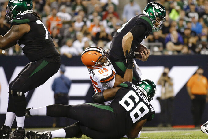 Cleveland Browns defensive end Myles Garrett (95) sacks New York Jets' quarterback Luke Falk (8) during the second half of an NFL football game Monday, Sept. 16, 2019, in East Rutherford, N.J. (AP Photo/Adam Hunger)