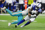 Miami Dolphins defensive back Nik Needham (40) tackles Indianapolis Colts wide receiver Zach Pascal (14) after a catch during the first half of an NFL football game in Indianapolis, Sunday, Nov. 10, 2019. (AP Photo/Darron Cummings)