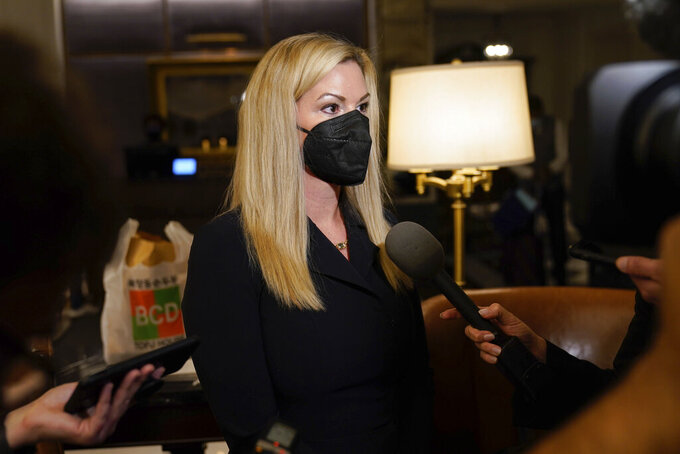 Melanie Coburn, a former employee of the Washington Football Team, speaks to reporter during the NFL football owners meeting in New York, Tuesday, Oct. 26, 2021. (AP Photo/Seth Wenig)