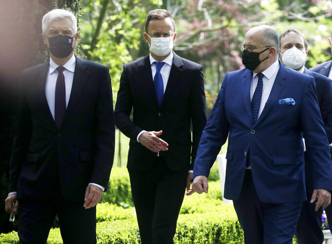 Slovak Foreign Minister Ivan Korcok, left, Polish Foreign Minister Zbigniew Rau ,Hungarian Foreign Minister Peter Szijjarto and Czech Republic Foreign Minister Tomas Petricek ,right, after the foreign ministers of the Visegrad Group V4, meeting in Lodz, Poland, Friday, May 14, 2021.(AP Photo/Czarek Sokolowski)