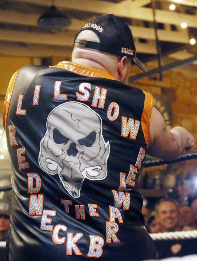 In this Jan. 9, 2020 photo, Jacob Brooks aka Lil Show the Redneck Brawler interacts with the crowd during the Micro Wrestling Federation match at the Parkway Brewing Company in Salem, Va. For as long as Jacob Brooks can remember, he wanted to be a professional wrestler. (Heather Rousseau/The Roanoke Times via AP)