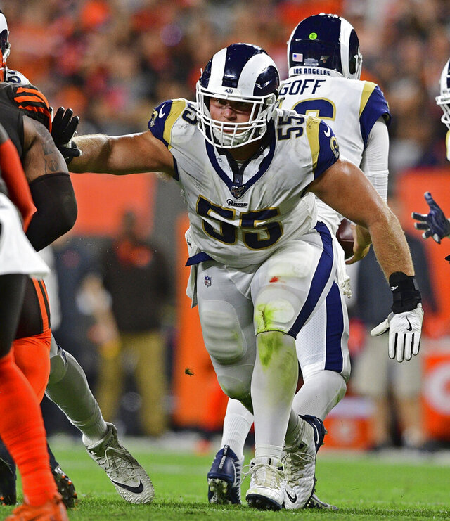 In this Sept. 22, 2019, photo, Los Angeles Rams center Brian Allen blocks during the second half of an NFL football game against the Cleveland Browns in Cleveland. Allen said Wednesday, April 15, 2020, that he tested positive for COVID-19 three weeks ago. Allen is the first active NFL player to acknowledge testing positive during the coronavirus pandemic. (AP Photo/David Dermer)