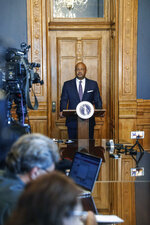 Indiana Attorney General Curtis Hill holds a press conference regarding the finding of more than 2,000 fetal remains in the garage of the Illinois home of deceased former Indiana abortion doctor, Ulrich Klopfer, at the Indiana Statehouse on Friday, Sept. 20, 2019, in Indianapolis, Ind. (Michelle Pemberton/The Indianapolis Star via AP)