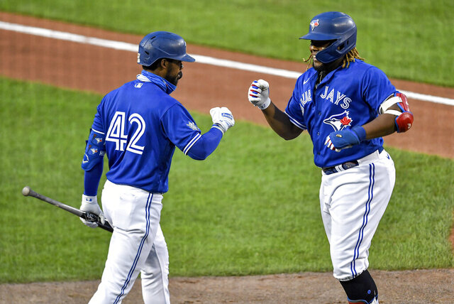 Toronto Blue Jays' Vladimir Guerrero Jr., right, celebrates his solo home run against the Baltimore Orioles with Teoscar Hernandez during the fourth inning of a baseball game in Buffalo, N.Y., Friday, Aug. 28, 2020. (AP Photo/Adrian Kraus)